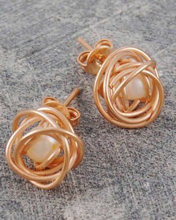 caged-pearl-rose-gold-stud-earrings-in-white